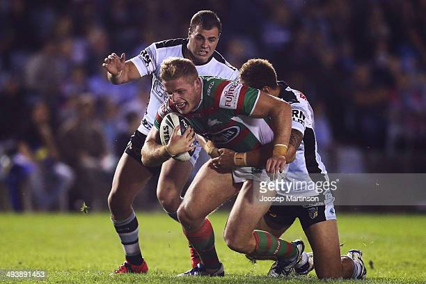 George Burgess of the Rabbitohs is tackled during the round 11 NRL match between the Cronulla-Sutherland Sharks and the South Sydney Rabbitohs at...