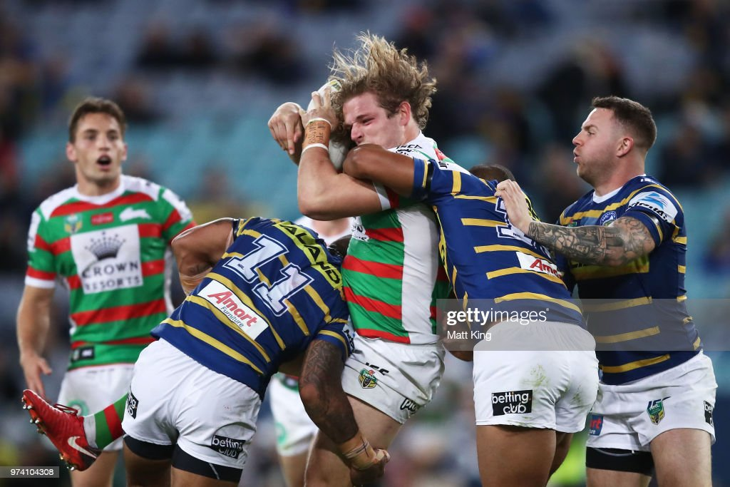 George Burgess of the Rabbitohs is tackled during the round 15 NRL match between the Parramatta Eels and the South Sydney Rabbitohs at ANZ Stadium on June 14, 2018 in Sydney, Australia.