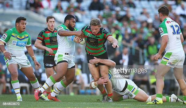 George Burgess of the Rabbitohs is tackled during the round 21 NRL match between the South Sydney Rabbitohs and the Canberra Raiders at ANZ Stadium...