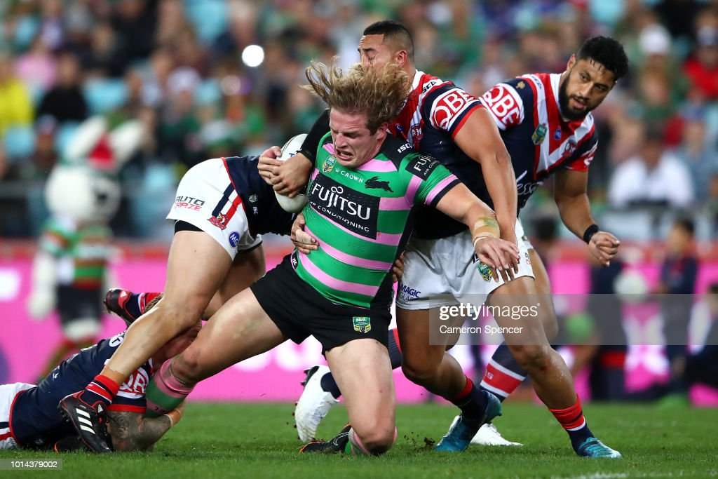 George Burgess of the Rabbitohs is tackled during the round 22 NRL match between the South Sydney Rabbitohs and the Sydney Roosters at ANZ Stadium on August 10, 2018 in Sydney, Australia.