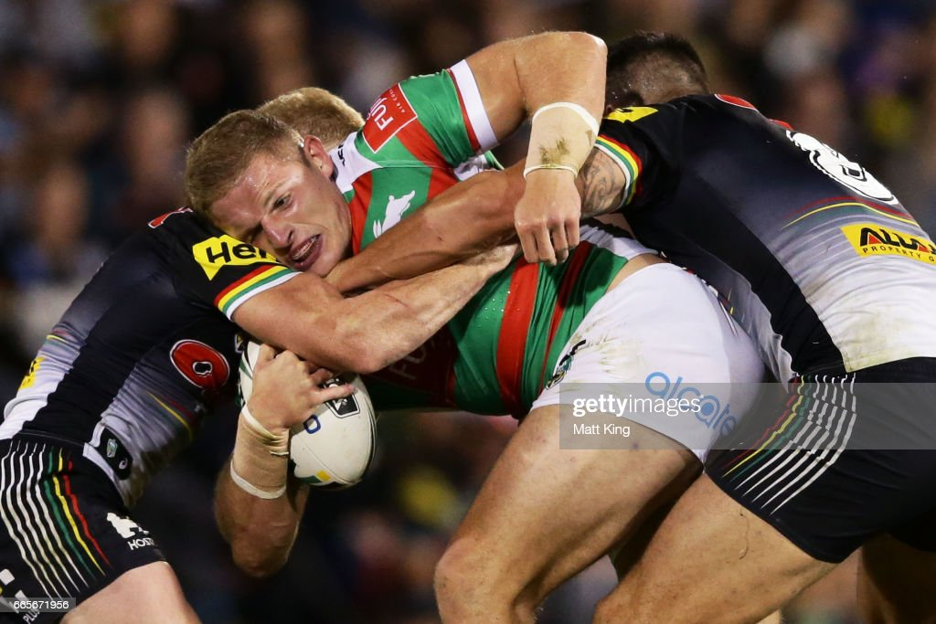 George Burgess of the Rabbitohs is tackled during the round six NRL match between the Penrith Panthers and the South Sydney Rabbitohs at Pepper Stadium on April 7, 2017 in Sydney, Australia.