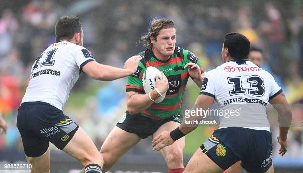George Burgess of the Rabbitohs looks to get past Jason Taumalolo of the Cowboys during the round 16 NRL match between the South Sydney Rabbitohs and...