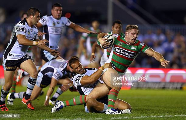 George Burgess of the Rabbitohs makes a break during the round 11 NRL match between the Cronulla-Sutherland Sharks and the South Sydney Rabbitohs at...