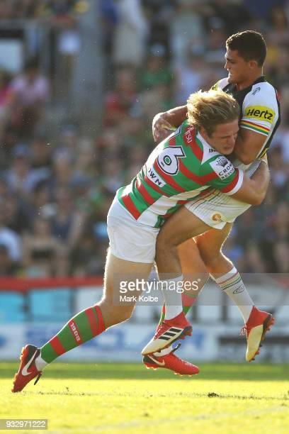 George Burgess of the Rabbitohs tackles Nathan Cleary of the Panthers after a kick during the round two NRL match between the Penrith Panthers and...