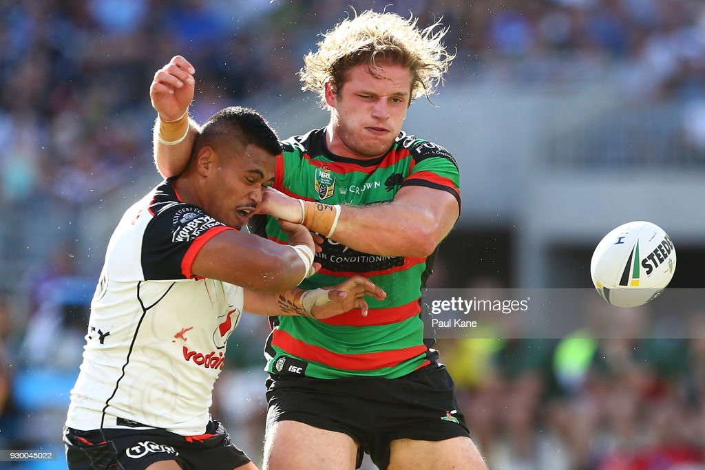 George Burgess of the Rabbitohs tackles Sam Lisone of the Warriors during the round one NRL match between the South Sydney Rabbitohs and the New Zealand Warriors at Optus Stadium on March 10, 2018 in Perth, Australia.