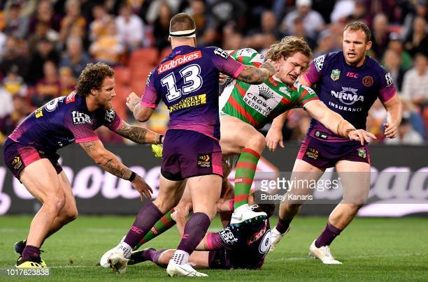 George Burgess of the Rabbitohs takes on the defence during the round 23 NRL match between the Brisbane Broncos and the South Sydney Rabbitohs at...