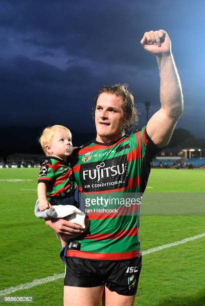 George Burgess of the Rabbitohs waves to the crowd with his son Boston at the end of the round 16 NRL match between the South Sydney Rabbitohs and...