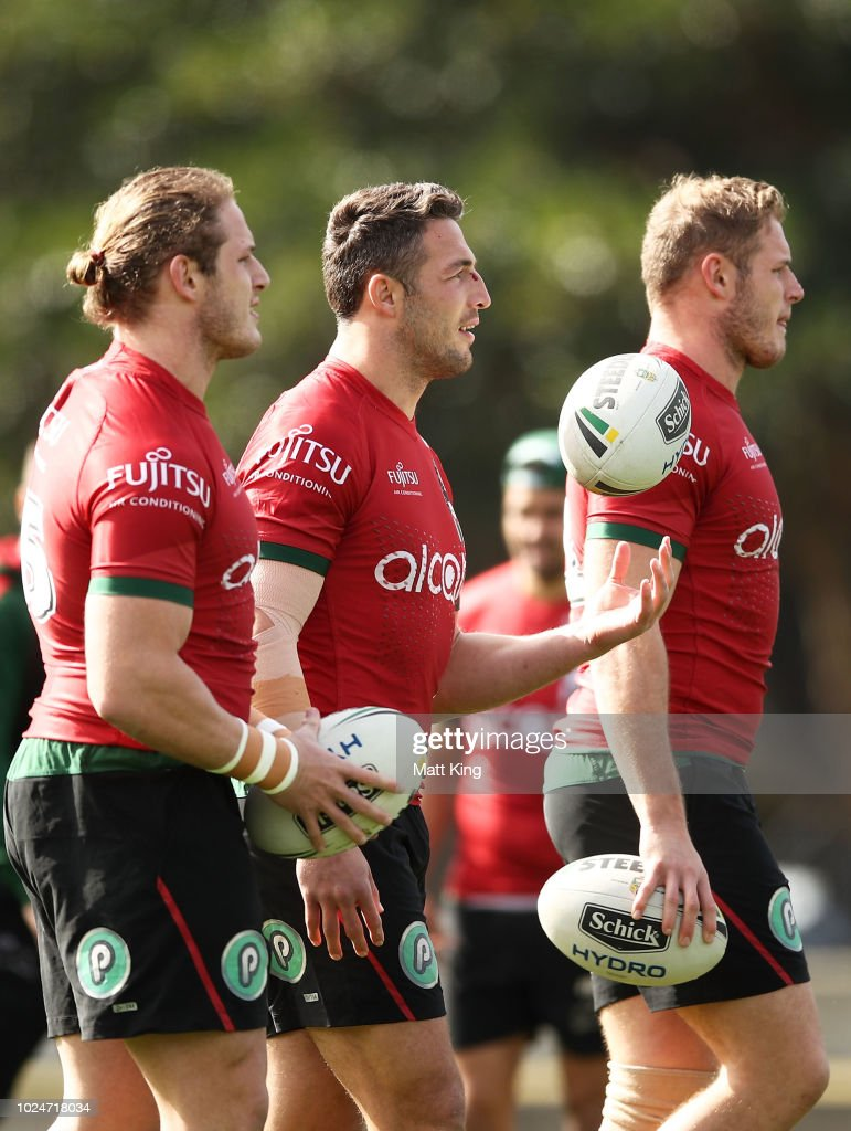 George Burgess, Sam Burgess and Tom Burgess look on during a South Sydney Rabbitohs NRL training session at Redfern Oval on August 28, 2018 in Sydney, Australia.