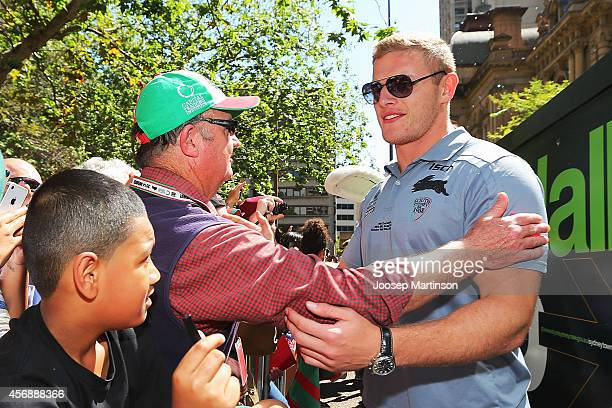 George Burgess talks to a fan during a South Sydney Rabbitohs NRL Grand Final celebration at Sydney Town Hall on October 9 2014 in Sydney Australia