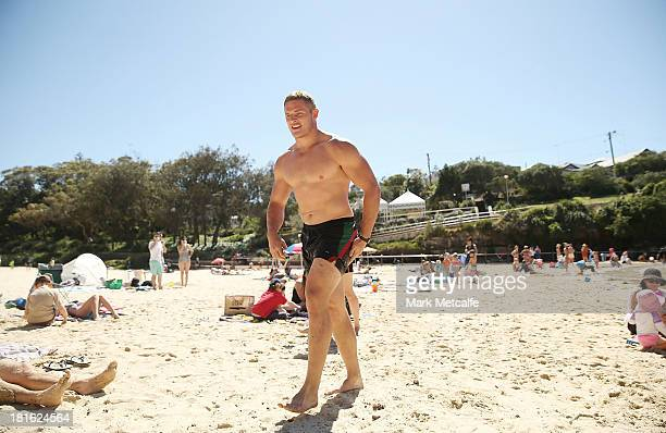 George Burgess walks from the ocean during a South Sydney Rabbitohs NRL recovery session at Clovelly Beach on September 23 2013 in Sydney Australia