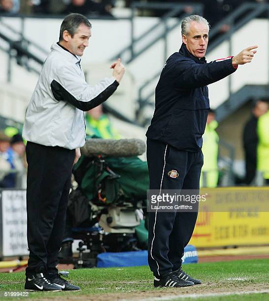 George Burley of Derby gives out intructions along side Mick McCarthy of Sunderland during the Coca-Cola Championship match between Derby County and...