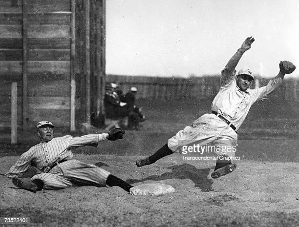 MARLIN TEXAS MARCH 14 1914 George Burns left and Art Fletcher leap and stretch during spring training drills for the New York Giants in Marlin Texas...