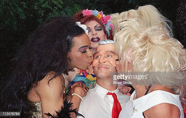 """""""George Bush"""" and drag queens during Wigstock 2004 at Thompson Square Park in New York City, New York, United States."""