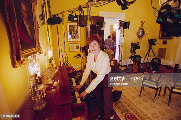 George Bush's wife Laura plays the piano while taking a break from a media event at the Governor's Mansion in Austin Texas Governor of Texas since...