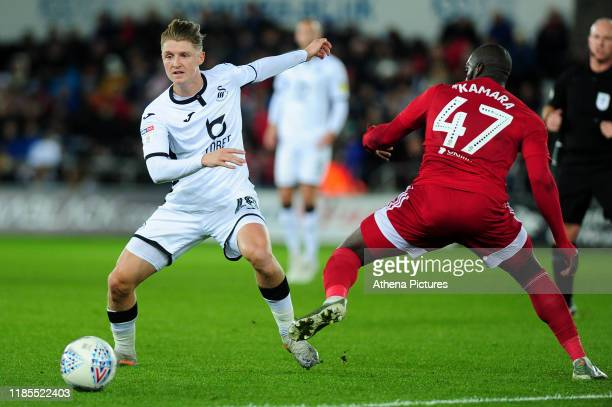 George Byers of Swansea City battles with Aboubakar Kamara of Fulham during the Sky Bet Championship match between Swansea City and Fulham at the...