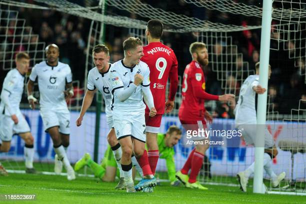 George Byers of Swansea City celebrates scoring his side's first goal during the Sky Bet Championship match between Swansea City and Fulham at the...