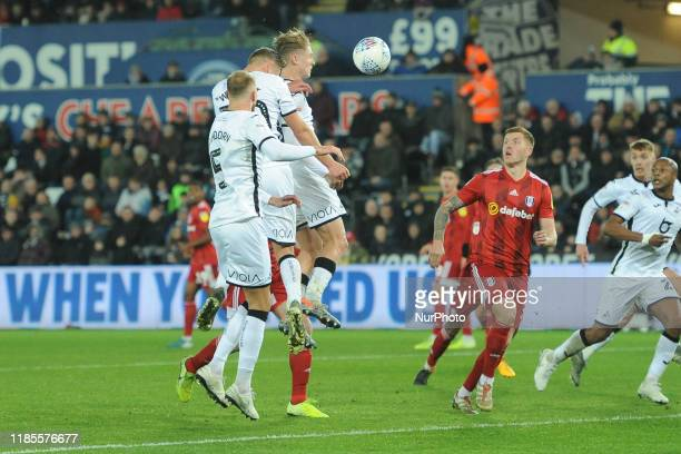 George Byers of Swansea City heads for goal and scores Swanseas first goal during the Sky Bet Championship match between Swansea City and Fulham at...