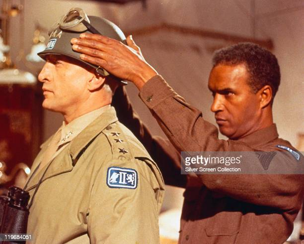 George C Scott , US actor, having his helmet with goggles put on by a soldier in a publicity still issued for the film, 'Patton', 1970. The biopic,...