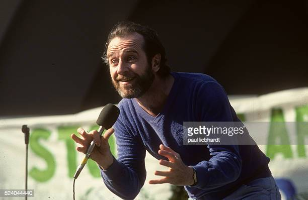 George Carlin comedian and satarist performs for the crowd at the Survival Sunday celebration on May 21 1978 at the Hollywood Bowl Los Angeles...