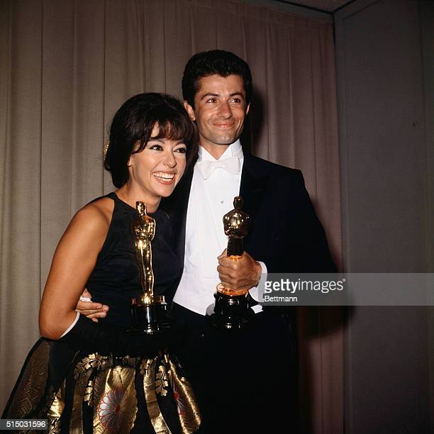 George Chakiris and Rita Moreno are shown here as they accept their Academy Awards