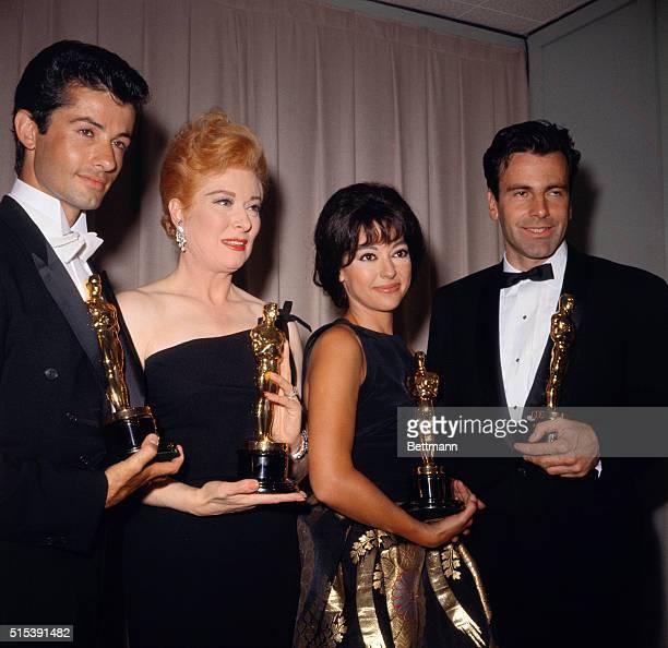 George Chakiris Greer Garson Rita Moreno and Maximilian Schell pose with their Oscars at the Academy Awards