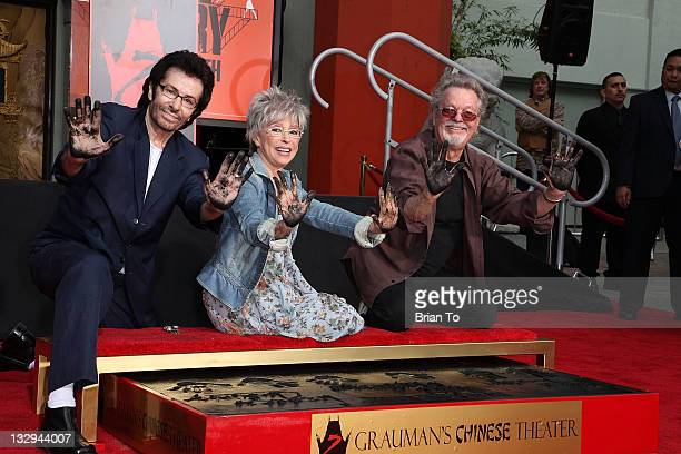 George Chakiris Rita Moreno and Russ Tamblyn attend West Side Story 50th anniversary hand footprint ceremony at Grauman's Chinese Theatre at...