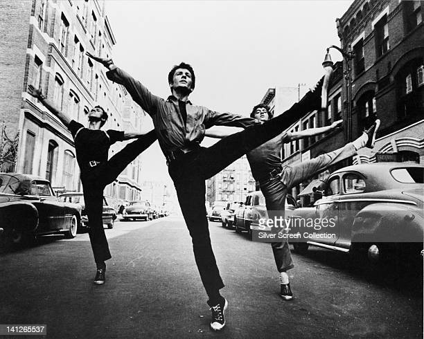 George Chakiris , US actor, dancing in the street in a publicity image issued for the film, 'West Side Story', USA, 1961. The musical, directed by...