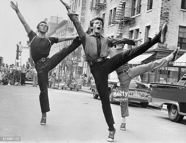 George Chakiris , who plays Bernardo, and two other dancers perform in a scene during the filming of the movie musical West Side Story on location in...