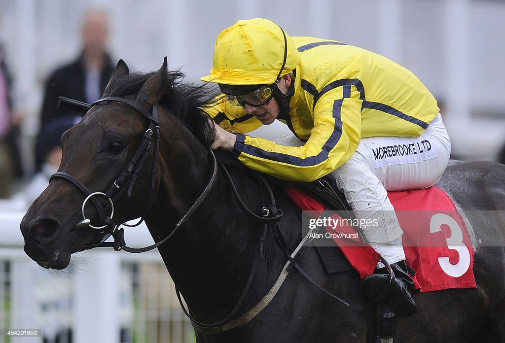 George Chaloner riding Jumeirah Glory to win The Rosebery Manor Nursery Handicap at Epsom racecourse on August 26, 2014 in Epsom, England.