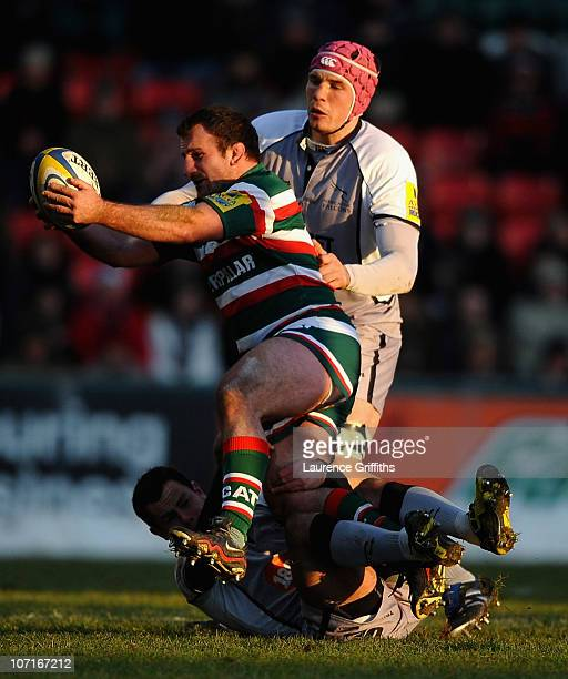 George Chuter of Leicester Tigers is tackled by Tim Swinson of Newcastle Falconsduring the AVIVA Premiership match between Leicester Tigers and...