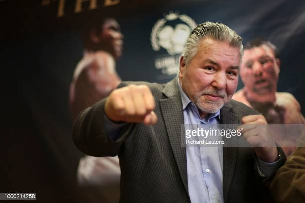 George Chuvalo strikes a familiar pose following the press conference in front of a poster of his fight against Mohammed Ali Global Legacy Boxing is...