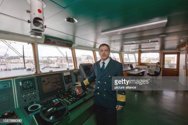 George Ciortan captain of the 'MS Deutschland' poses at the helm in Kiel Germany 09 June 2015 The ship made famous by the television series 'Das...