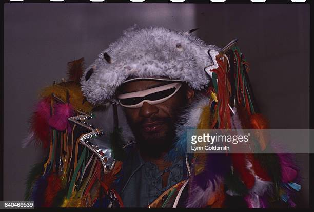 George Clinton in Fur Hat and High Collared Jacket Decorated with Feather Plumes