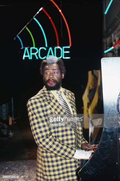 George Clinton plays a video game machine for the filming of his 'Atomic Dog' music video