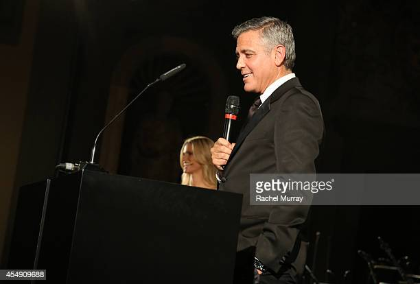 George Clooney accepts award during the Celebrity Fight Night gala celebrating Celebrity Fight Night In Italy benefitting The Andrea Bocelli...