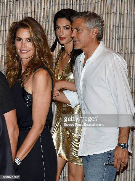 George Clooney Amal Alamuddin and Cindy Crawford attend the official launch of Casamigos Tequila in Ibiza at Ushuaia Ibiza Beach hotel on August 23...