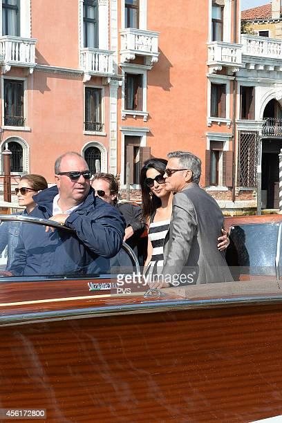 George Clooney, Amal Alamuddin, Rande Gerber and Cindy Crawford arrive in Venice on September 26, 2014 in Venice, Italy. George Clooney is set to...