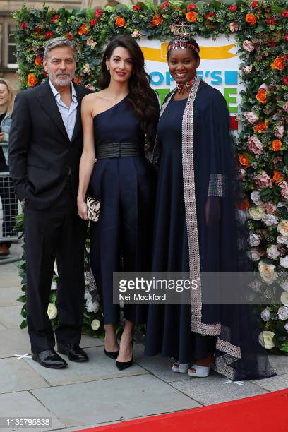 George Clooney Amal Clooney and Nice Nailantei Lengete attend the People's Postcode Lottery Charity Gala at McEwan Hall on March 14 2019 in Edinburgh...