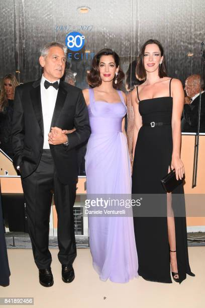 George Clooney Amal Clooney and Rebecca Hall attend the 'Hollywood Foreign Press Association Cocktail Party' during the 74th Venice Film Festival on...