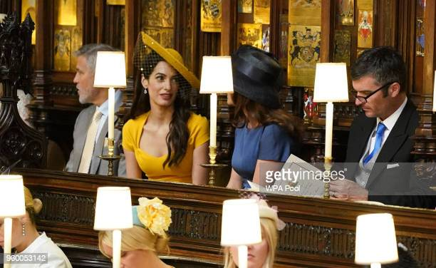 George Clooney Amal Clooney Silver Tree and Abraham Levy take their seats in St George's Chapel at Windsor Castle before the wedding of Prince Harry...