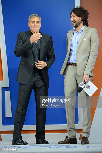 George Clooney and Alex Zane attend the Tomorrowland A World Beyond European premiere at Leicester Square on May 17 2015 in London England