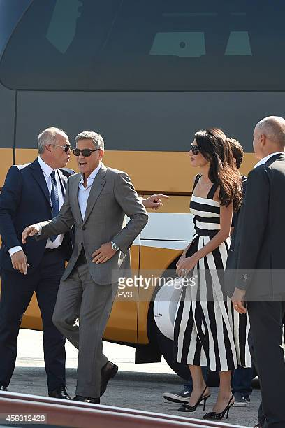 George Clooney and Amal Alamuddin arrive in Venice on September 28 2014 in Venice Italy George Clooney is set to marry his lawyer fiancee Amal...