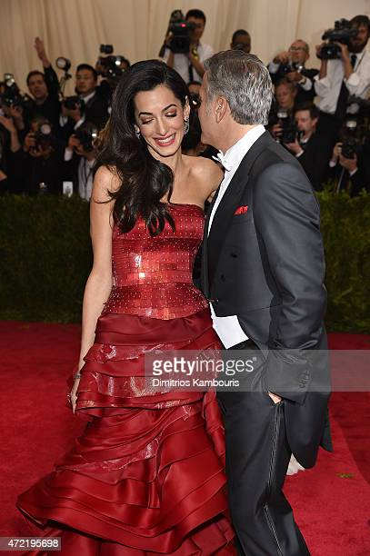 George Clooney and Amal Alamuddin attend the 'China Through The Looking Glass' Costume Institute Benefit Gala at the Metropolitan Museum of Art on...