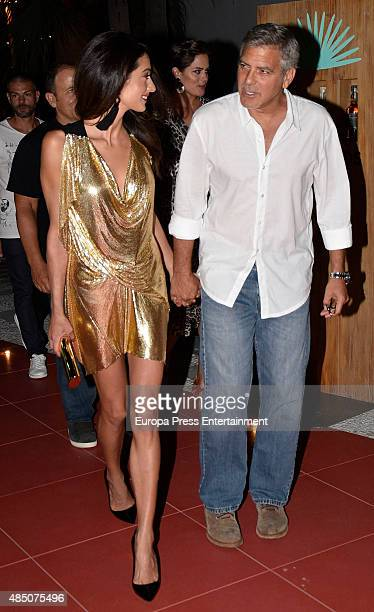 George Clooney and Amal Alamuddin attend the official launch of Casamigos Tequila in Ibiza at Ushuaia Ibiza Beach hotel on August 23 2015 in Ibiza...