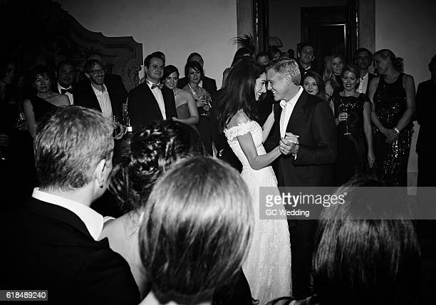 George Clooney and Amal Alamuddin dance during the George Clooney and Amal Alamuddin Wedding on September 27 2014 in Venice Italy