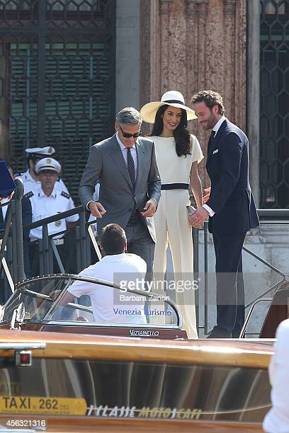 George Clooney and Amal Alamuddin leave the Venice City Hall Palazzo Ca' Farsetti after their wedding on September 29 2014 in Venice Italy