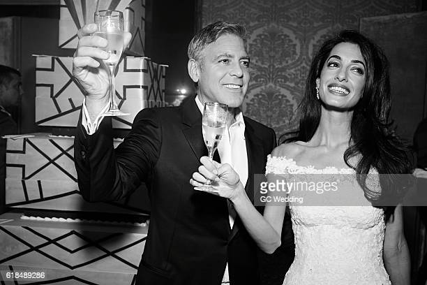 George Clooney and Amal Alamuddin toast atGeorge Clooney and Amal Alamuddin Wedding on September 27 2014 in Venice Italy