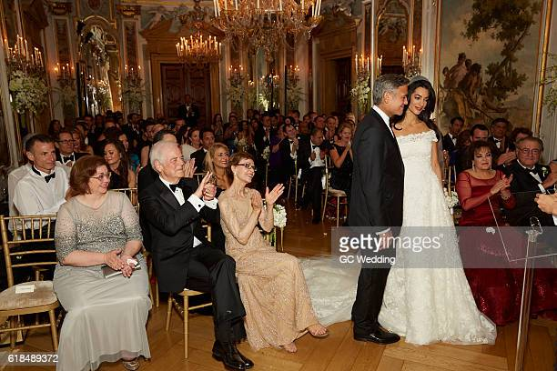 George Clooney and Amal Alamuddin wed as parents Nina Bruce Warren Nick Clooney Baria Alamuddin and Ramzi Alamuddin look on during the George Clooney...