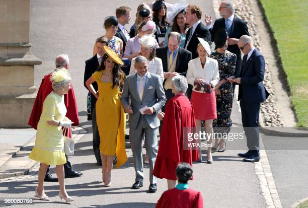 George Clooney and Amal Clooney ahead of Tom Hardy and Charlotte Riley arriving for the wedding of Prince Harry and Meghan Markle at Windsor Castle...