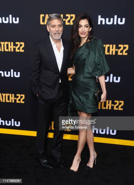 """George Clooney and Amal Clooney arrive at the U.S. Premiere of Hulu's """"Catch-22"""" at the TCL Chinese Theatre on May 07, 2019 in Hollywood, California."""